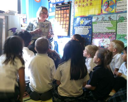 IMU's Meredith Atwood engages students in what looks to be a riveting story time!