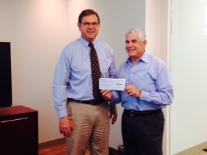 OBTI President John Wurzler (right) presents sponsorship check to Georgia State's David Buechner.